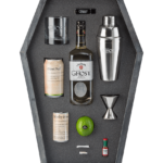 Branded materials included highball glass, shaker, jigger, mixers, and ingredients, all housed in laser-cut protective foam